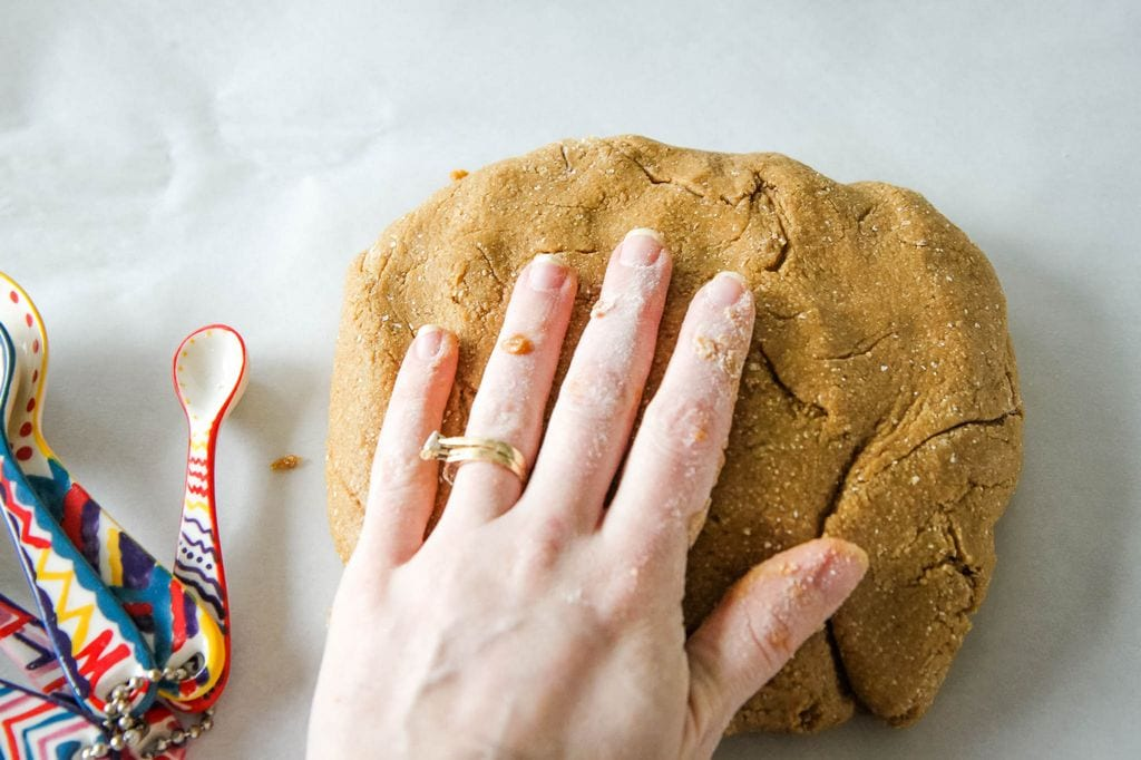 patting the gingerbread biscotti dough